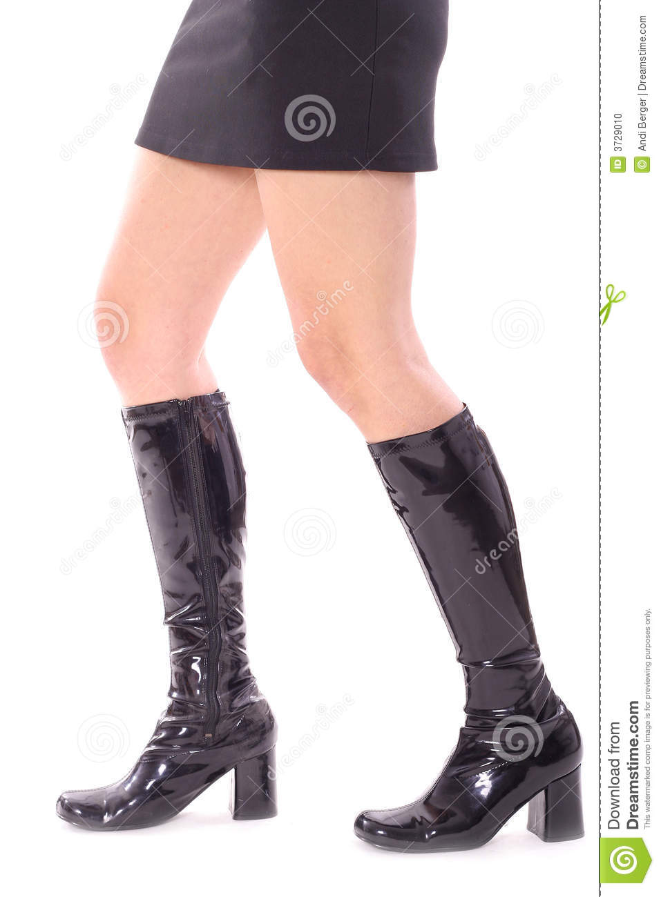 Sexy legs walking in leather boots isolated on a white background.
