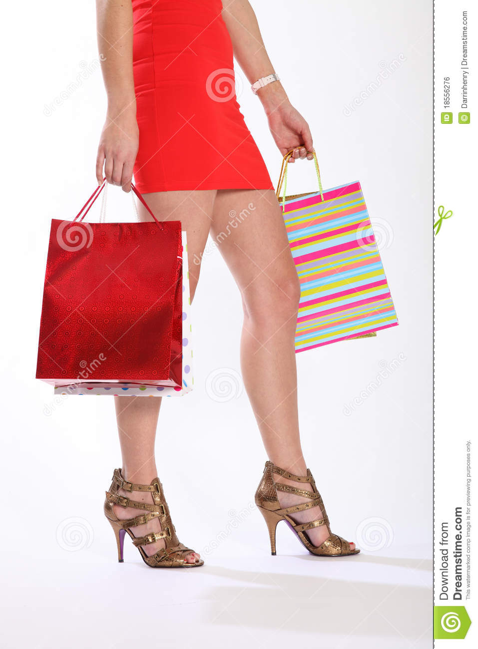 Legs Of Woman Walking With Shopping Bags