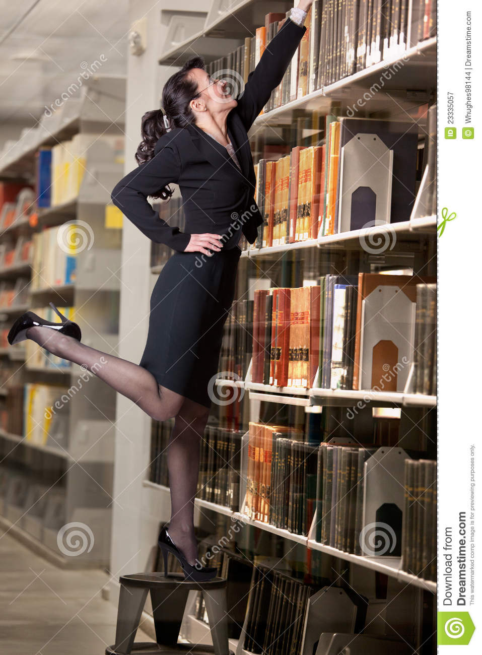 ... Reaching For A Book Royalty Free Stock Photography - Image: 23335057