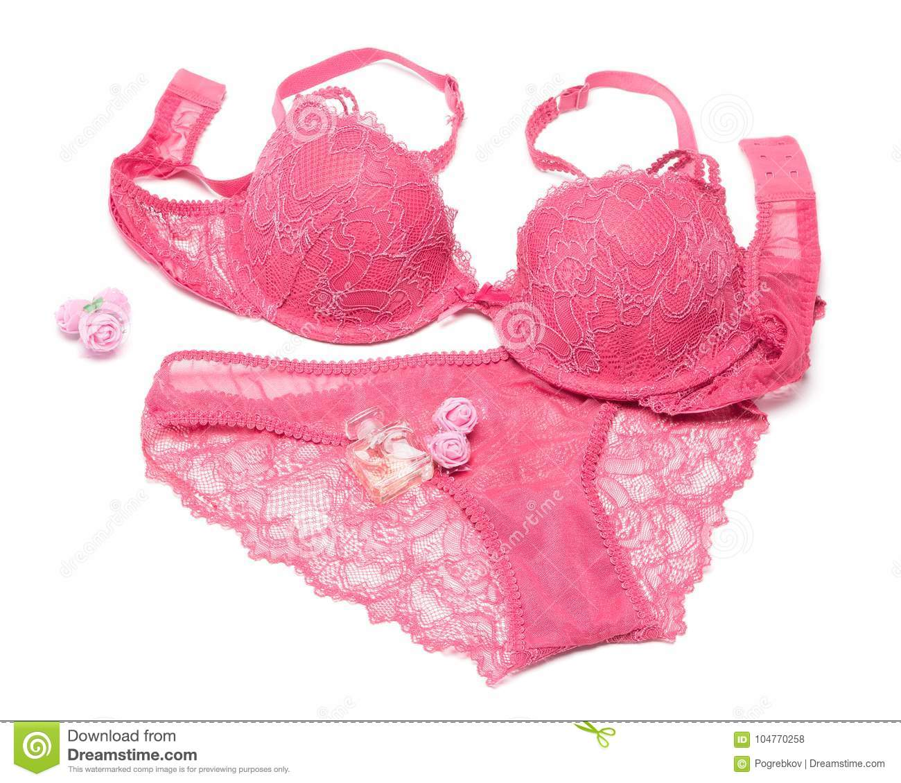 a5fc4e8745 lingerie set of bra and panty with perfume and small rose flowers on white  background. Glamorous woman accessories