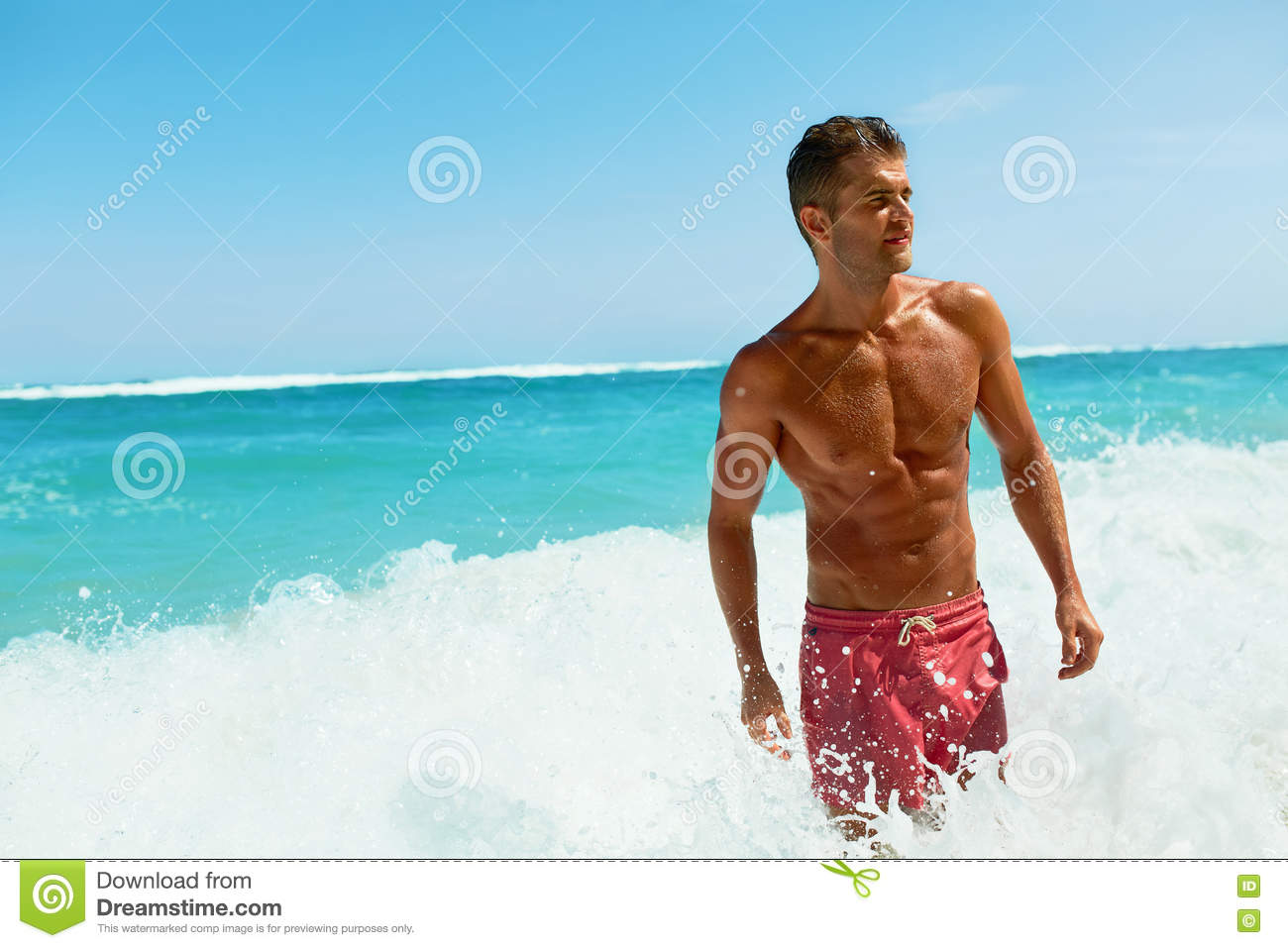 Marvelous Man On Beach In Summer. Male Relaxing Near Sea. Healthy, Coming.