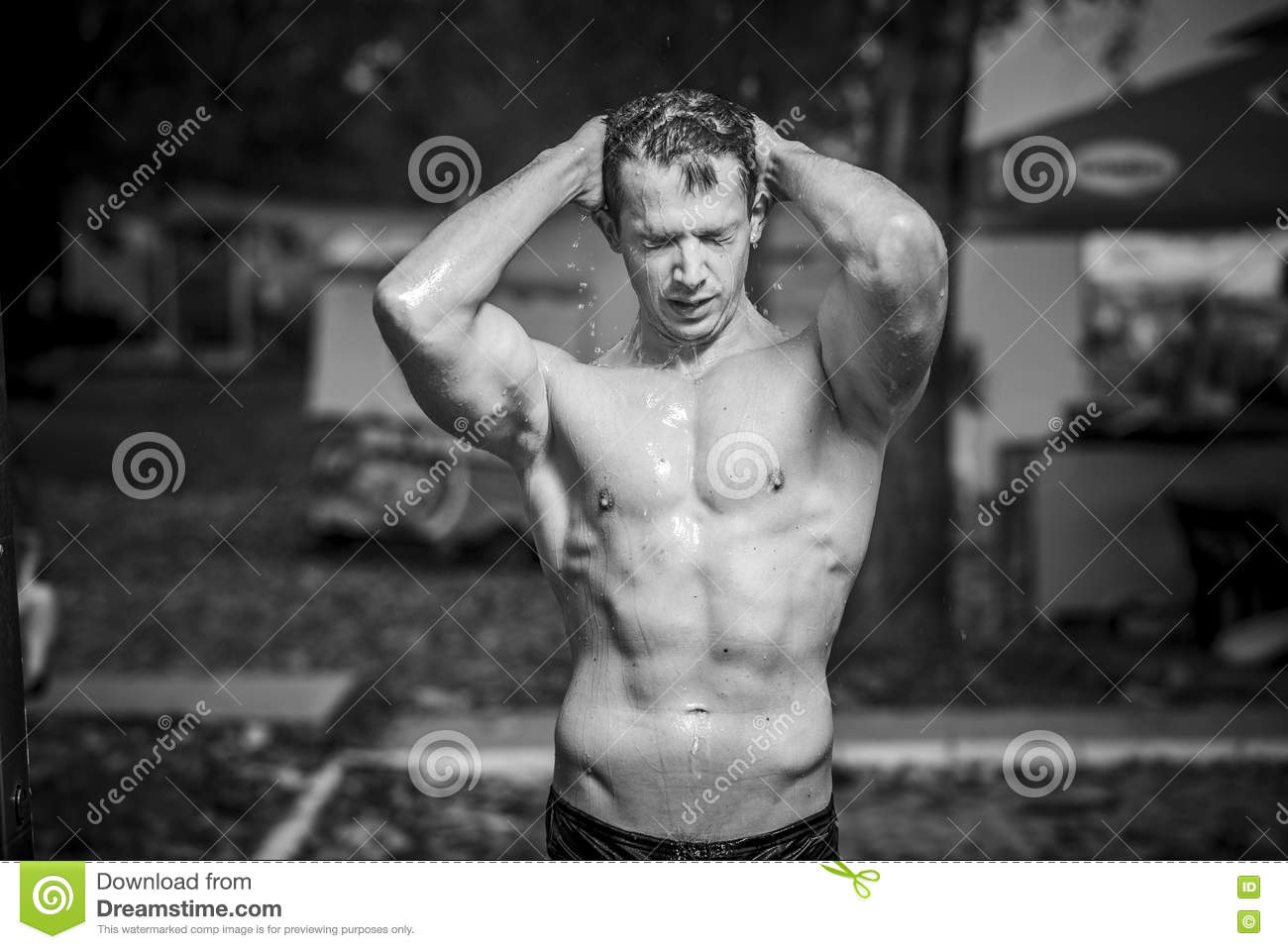 Good Looking Athletic Very Attractive Caucasian Man Enjoying A Fresh Shower On A Beach