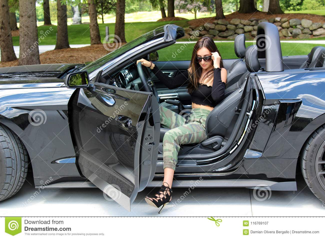 model in sport car beautiful girl with a ford mustang roush stage 3