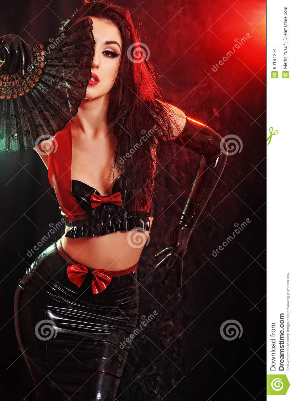 model wearing latex outfit and gloves