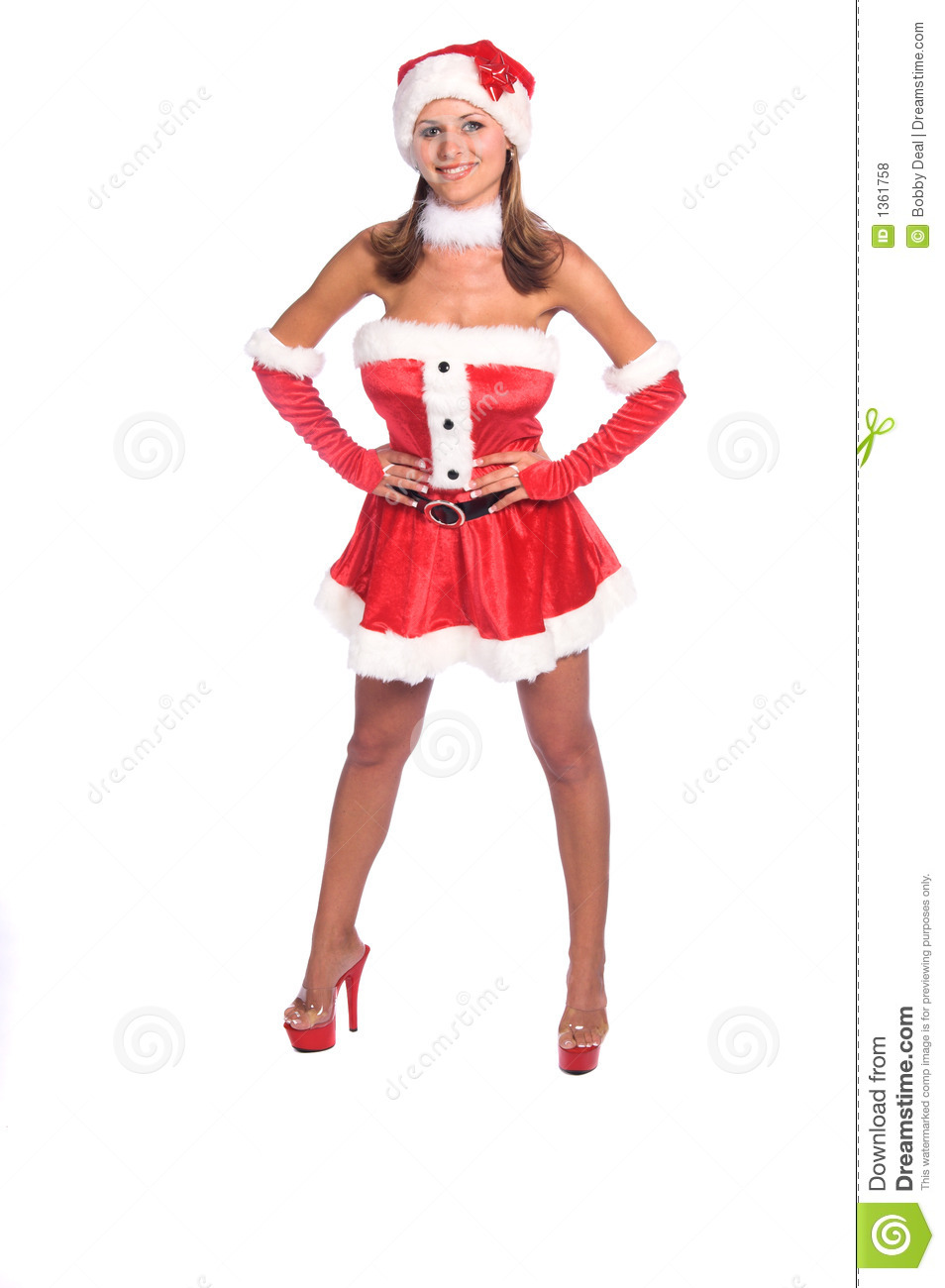 Sexy Ms. Santa Claus dressed in a red velvet dress and Santa hat ...