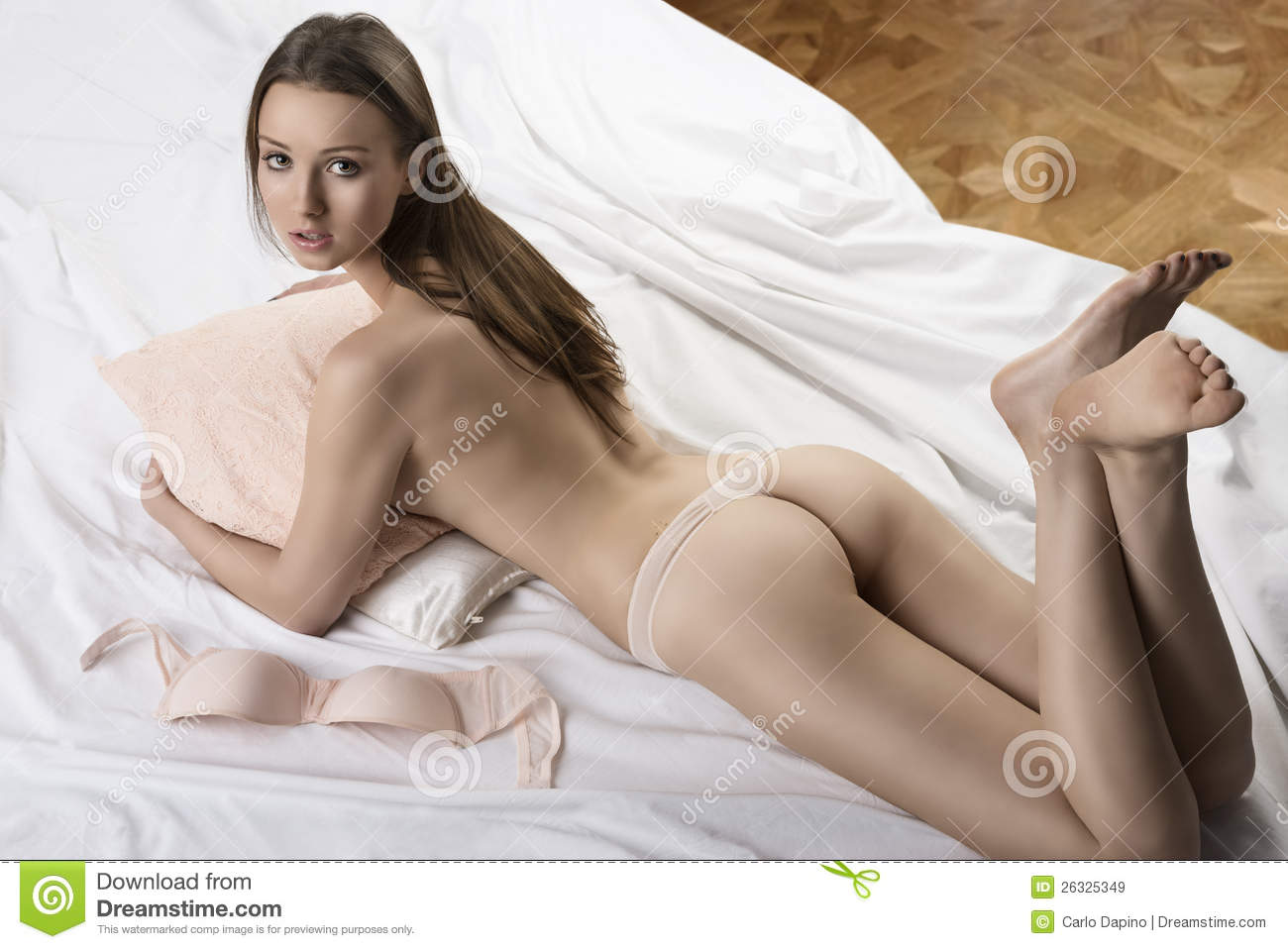Nude girl on bed from behind