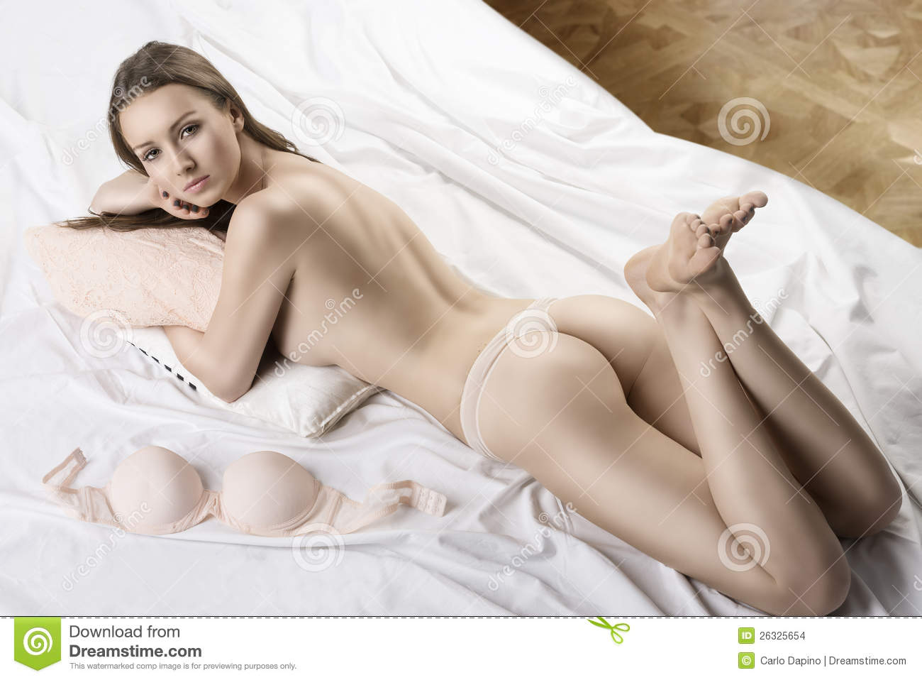 Nude female on bed