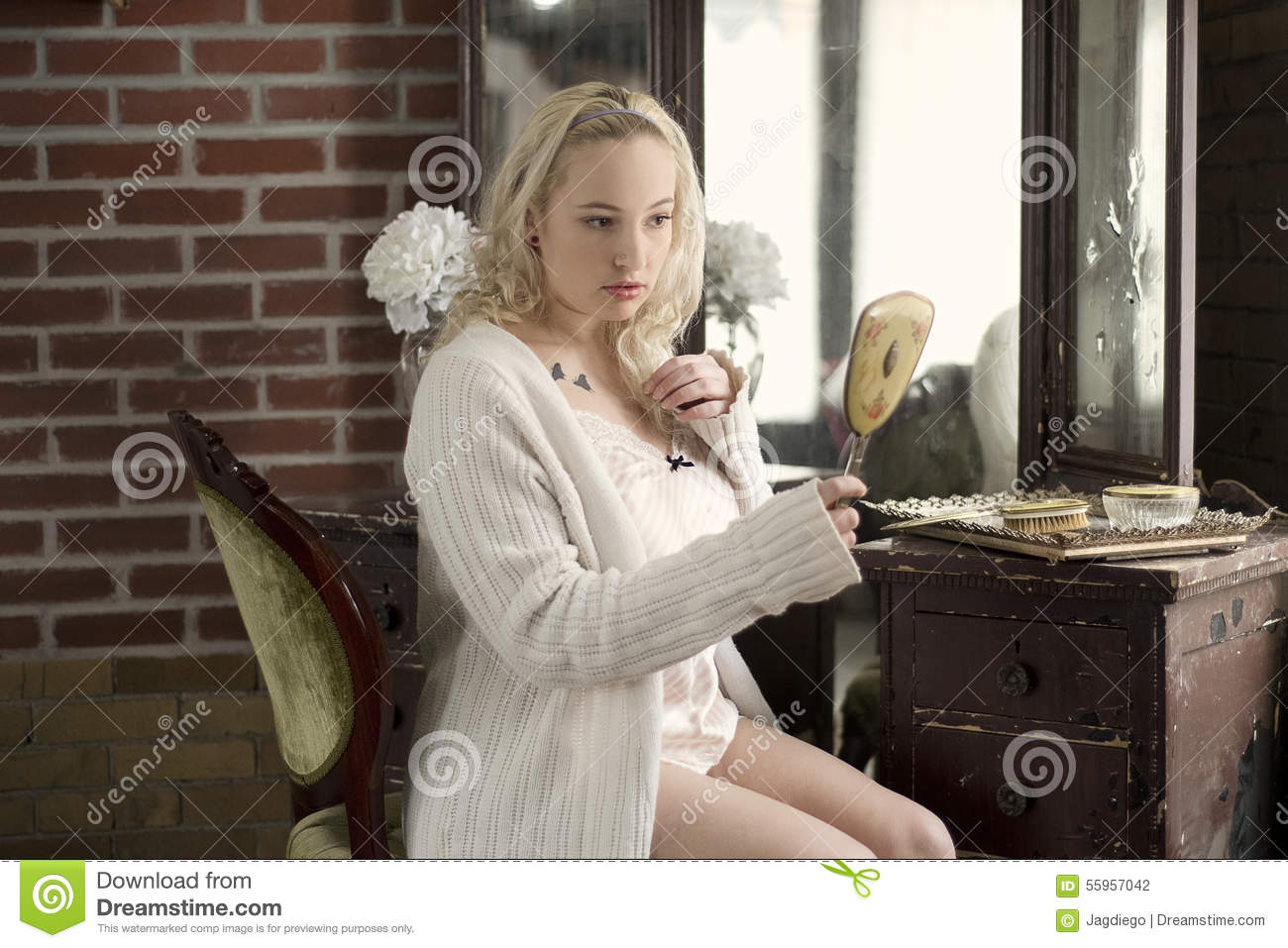 Plus Size Woman Looking In A Handheld Mirror Stock Photo