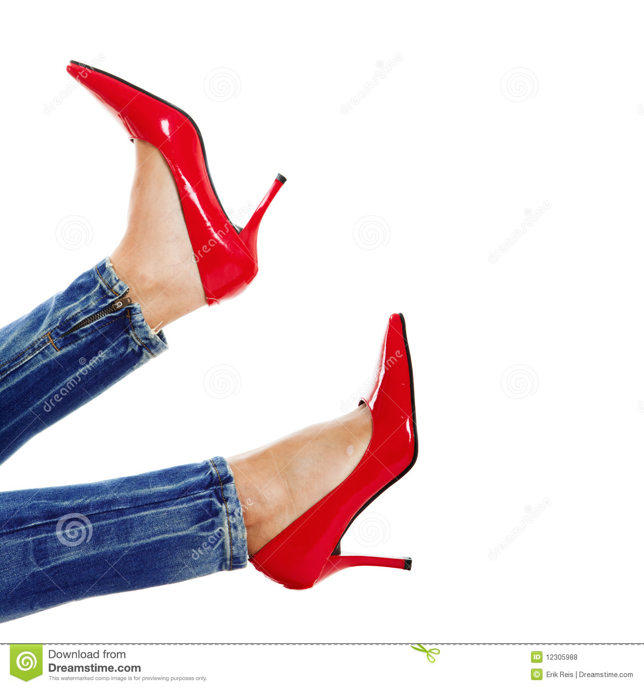 Female legs with sexy red shoes isolated in white
