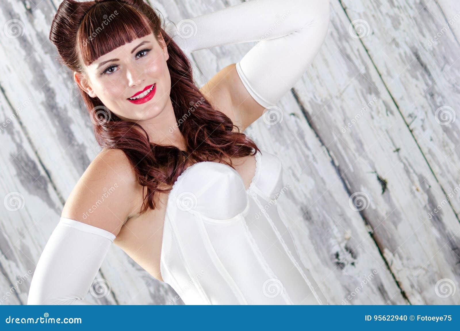 e9cd794db71 red hair 50s retro pinup boudoir woman in lingerie night gown. Model has  light soft skin