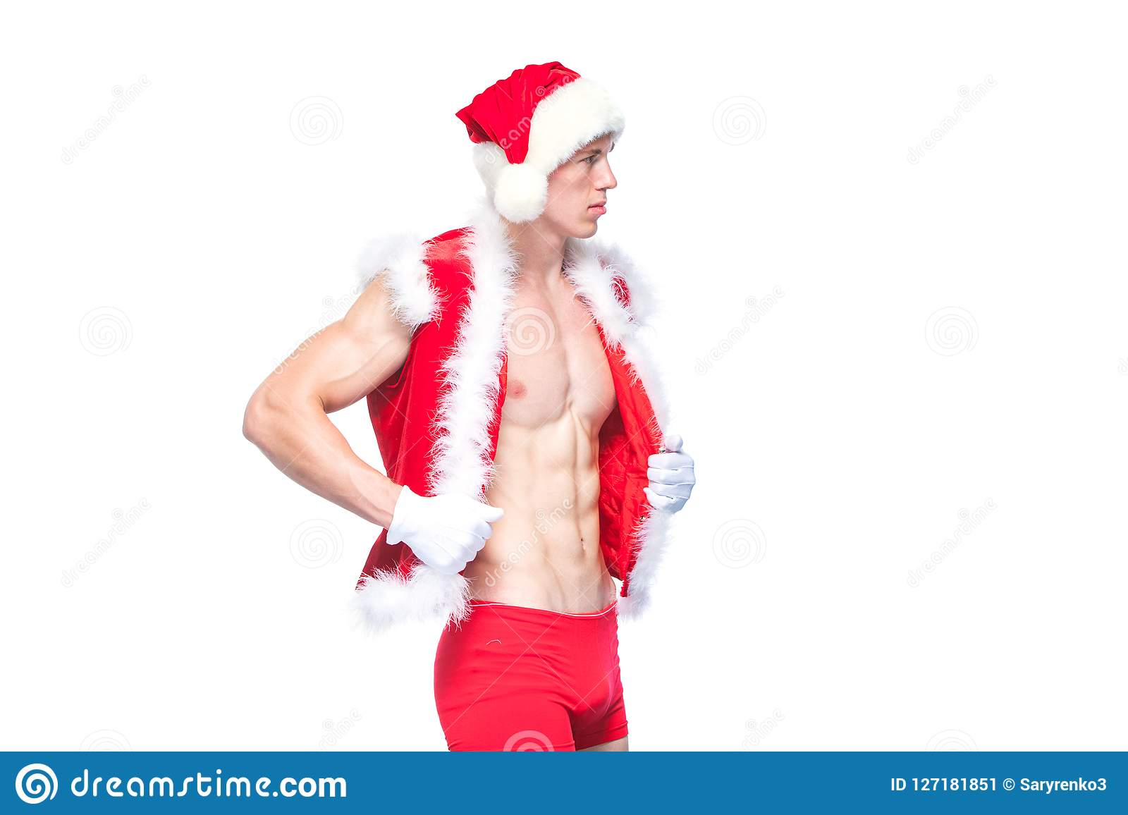 46ffbb5abd7cc Santa Claus . Young muscular man wearing Santa Claus hat demonstrate his  muscles. Isolated on white background