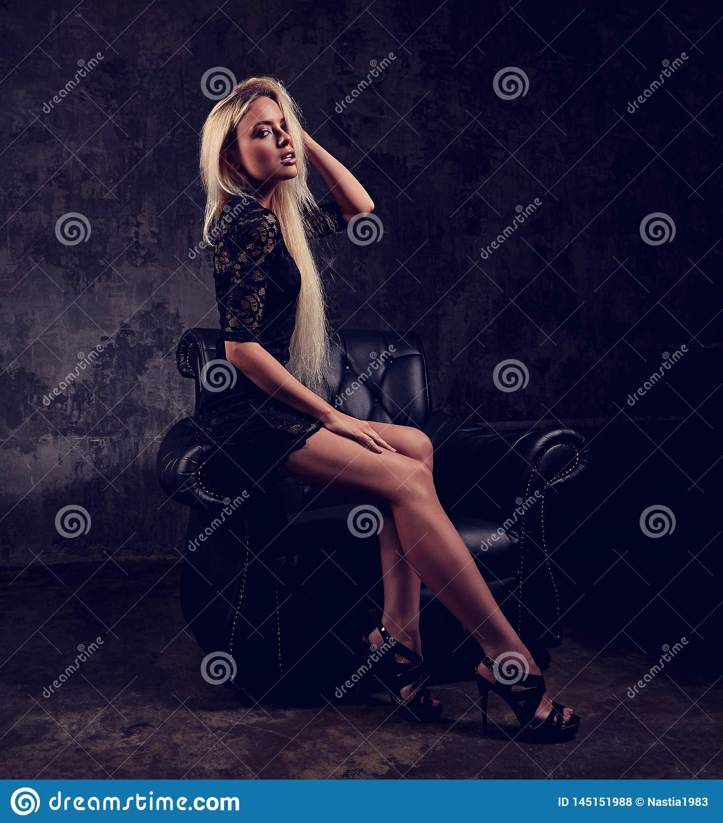 Black Fashion Models Poses: Slim Blod Model Sitting In Fashion Armchair In Black Dress