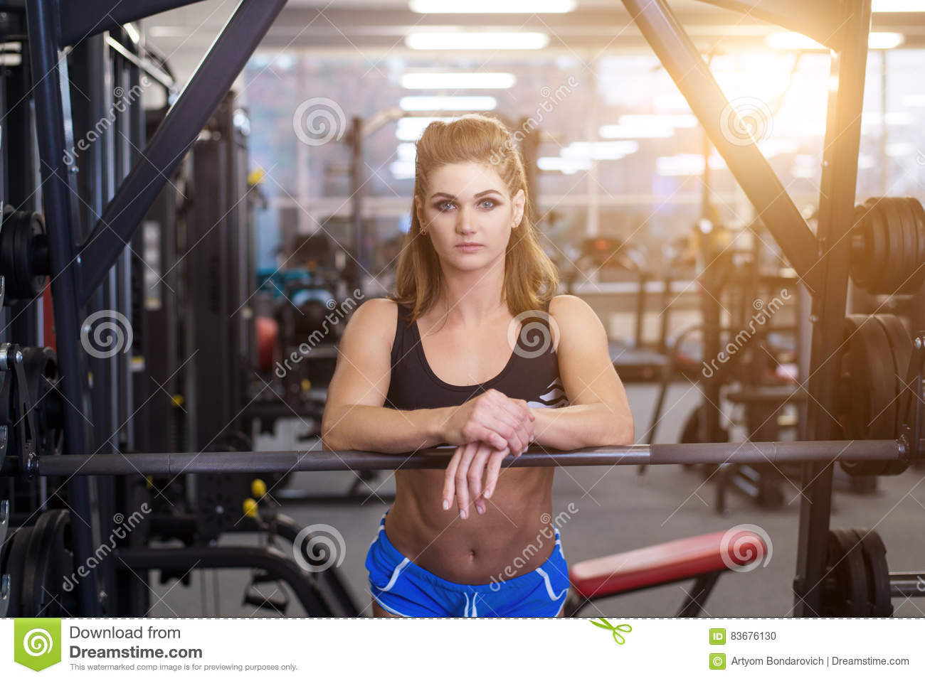 a866b0779b sporty woman doing power fitness exercise at sport gym. Beautiful girl  working out in gym.