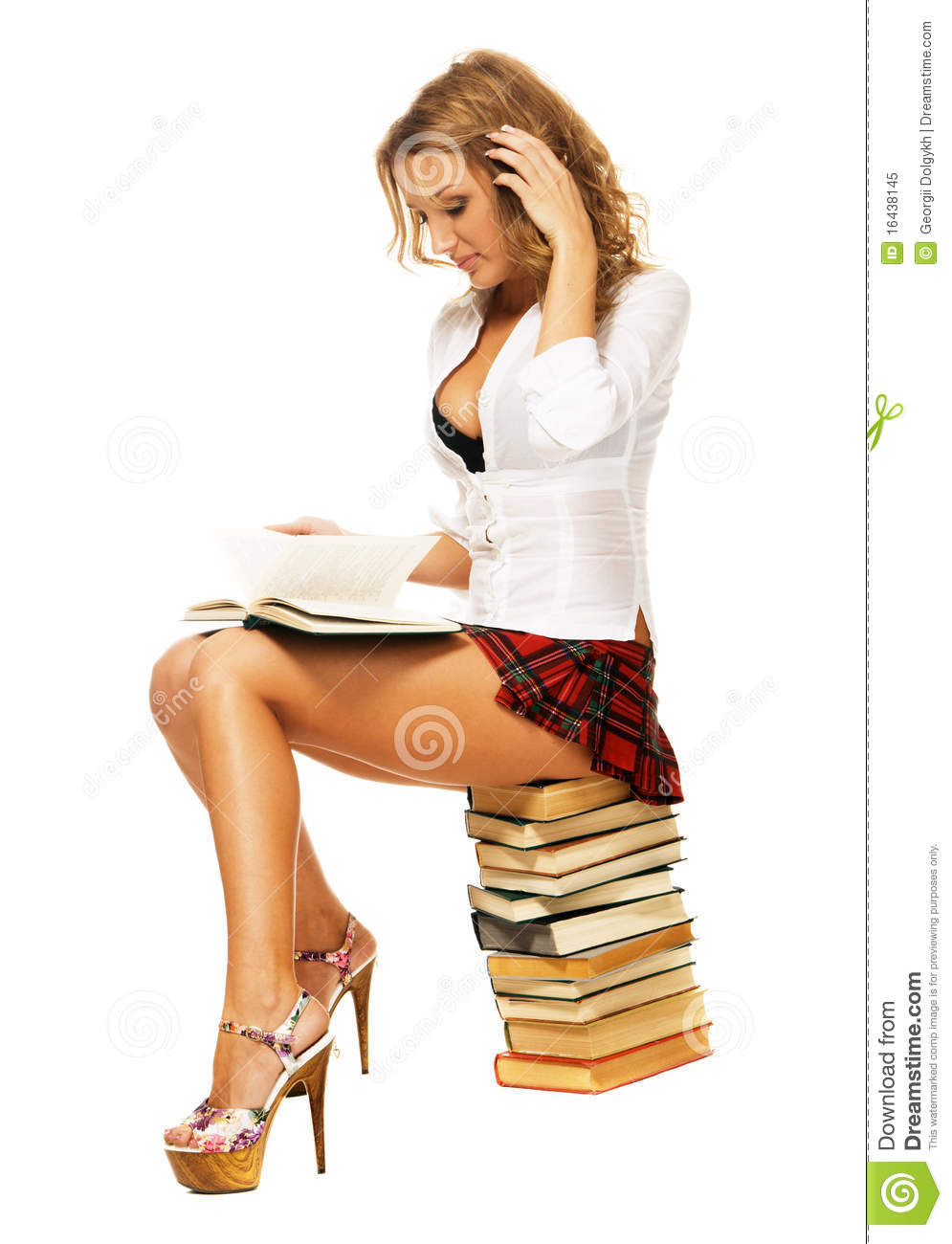 student girl with a stack of books