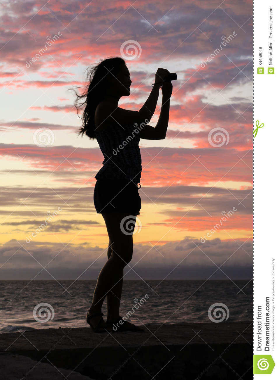 Sunset Silhouette of Woman Taking Photos