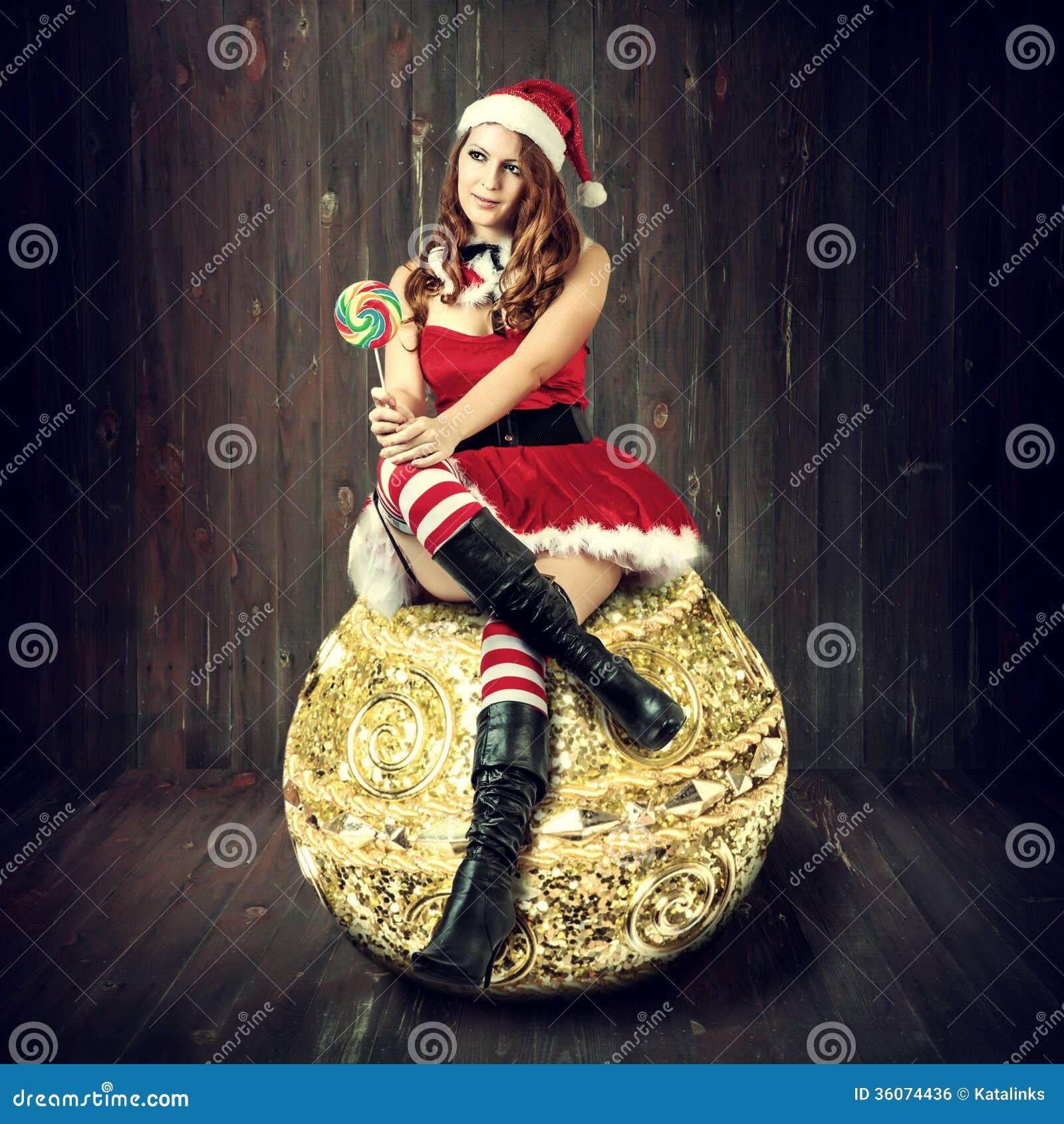 sexy weihnachtsfrau in weihnachtsmann kleidung stockfoto. Black Bedroom Furniture Sets. Home Design Ideas