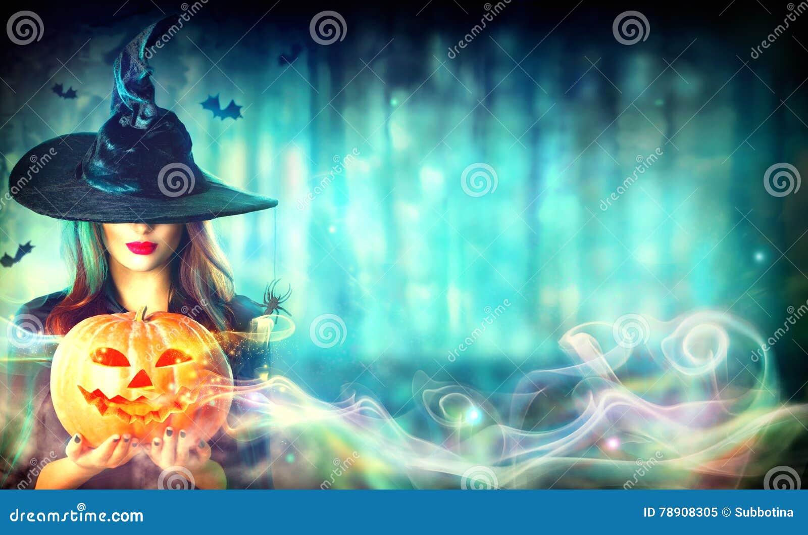 witch with a Halloween pumpkin Jack-o-lantern