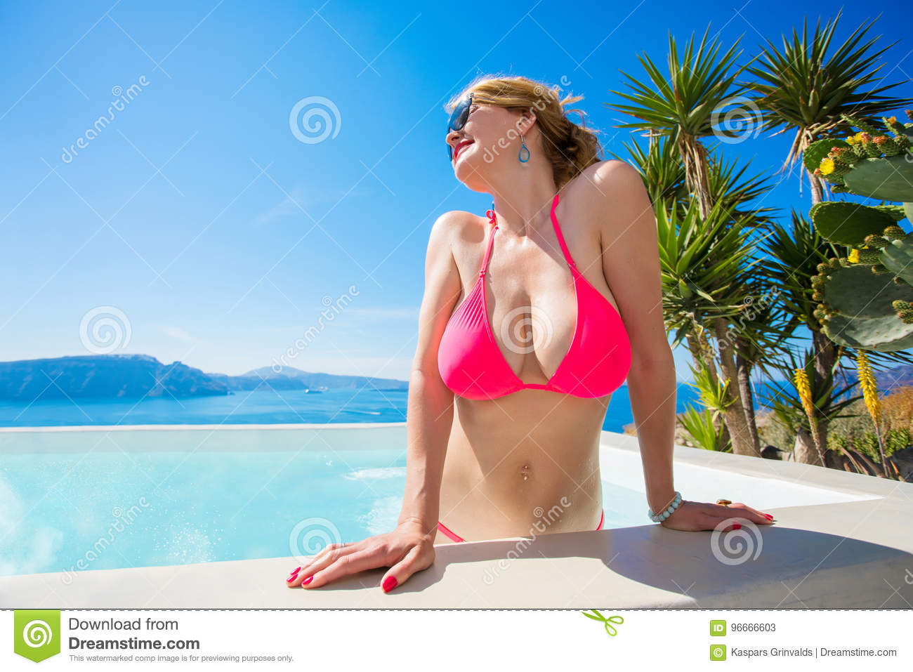 woman with big boobs getting out of pool stock image - image of