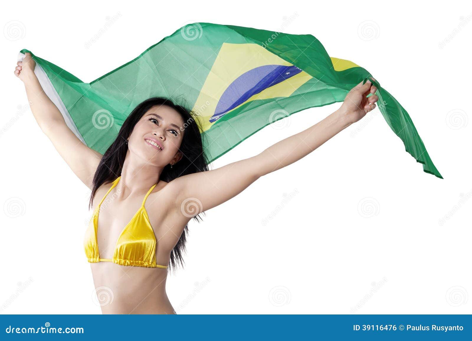 9652f25aa27 Beautiful young woman holding Brazil flag wearing bikini. isolated on white