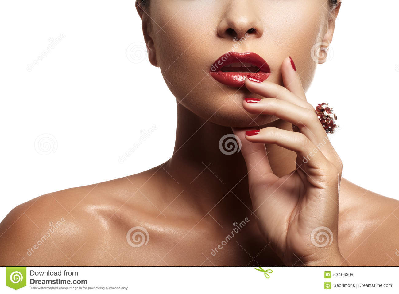 woman with evening red lips makeup and bright red manicure