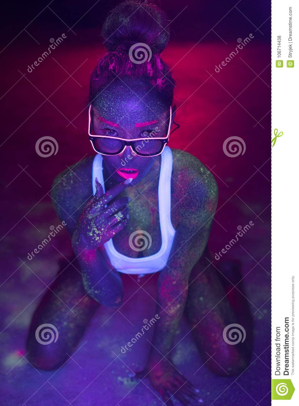 woman with UV fluorescent face and body makeup
