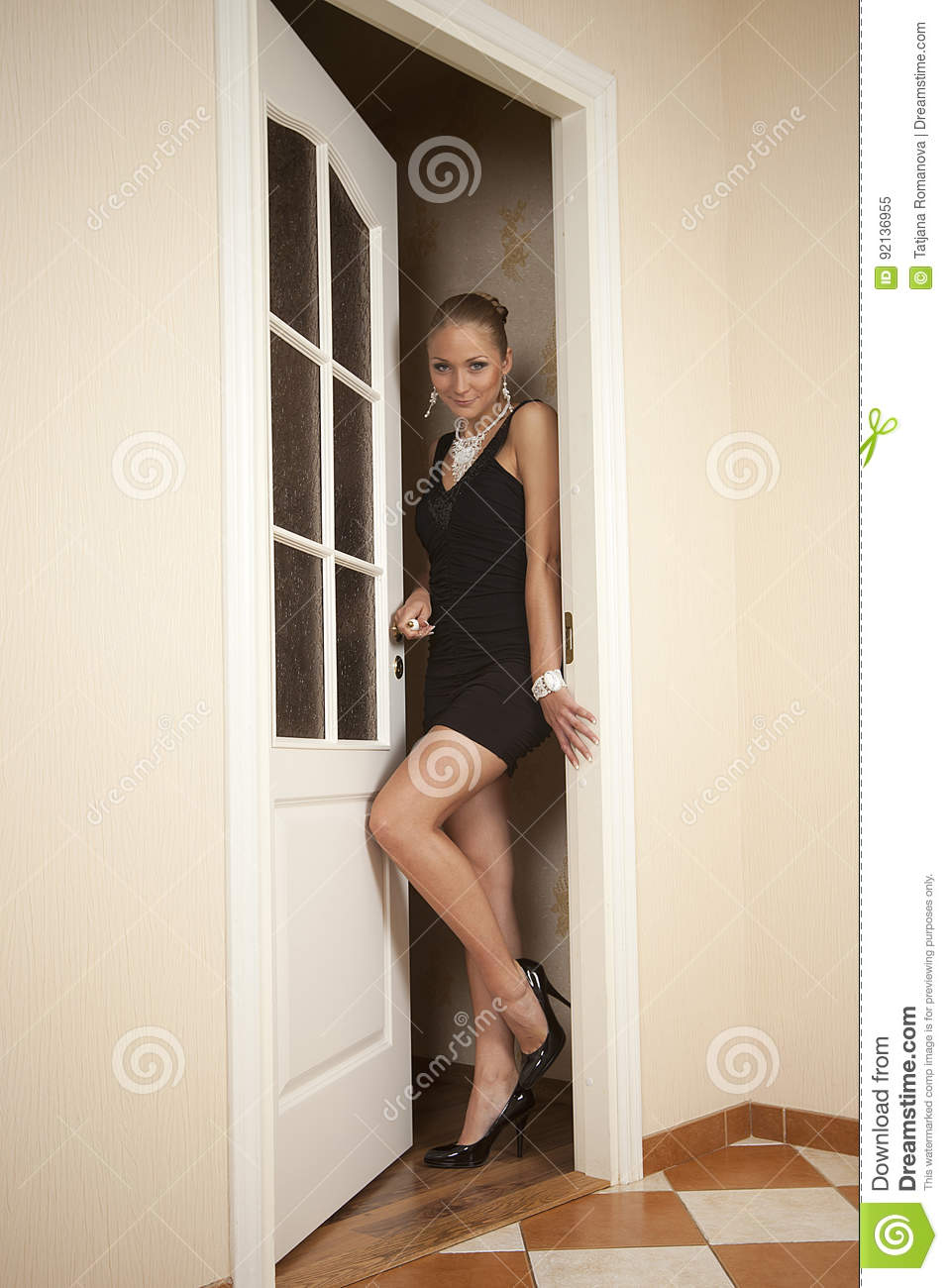 Sexy woman goes out the door