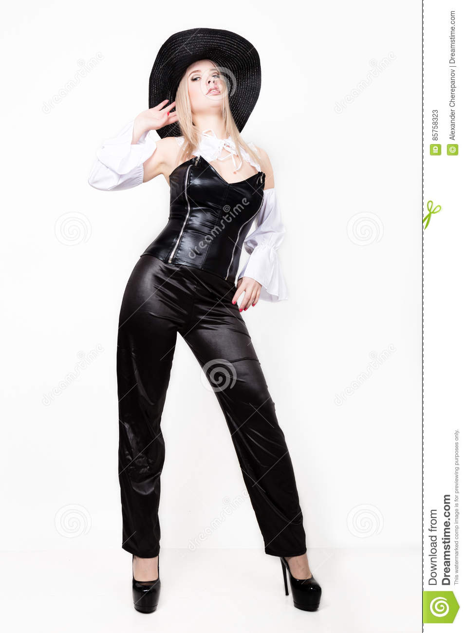 Woman With Hourglass Figure Dressed In Black Leather Corset