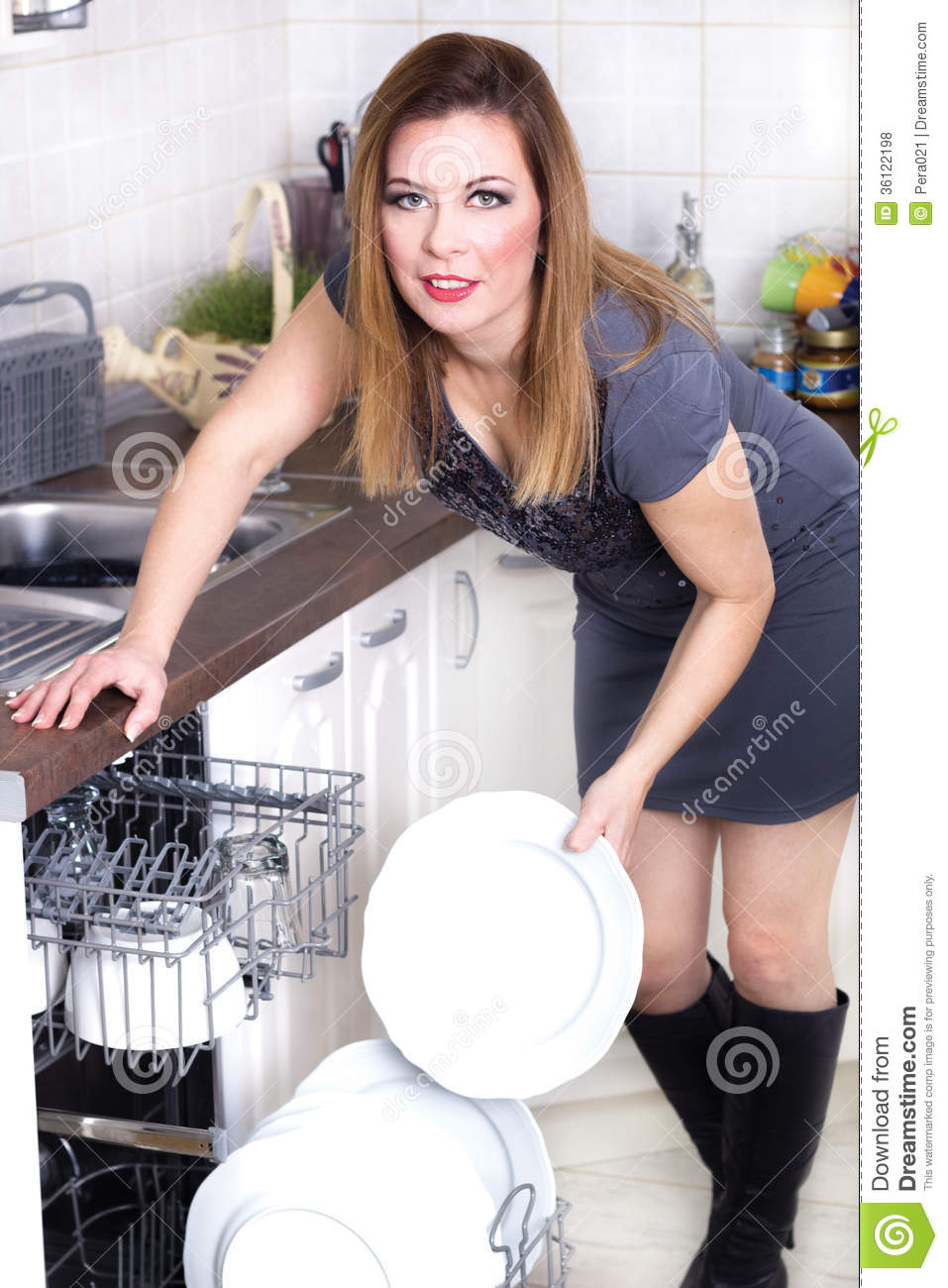 Sexy Woman In Kitchen Doing Housework Royalty Free Stock