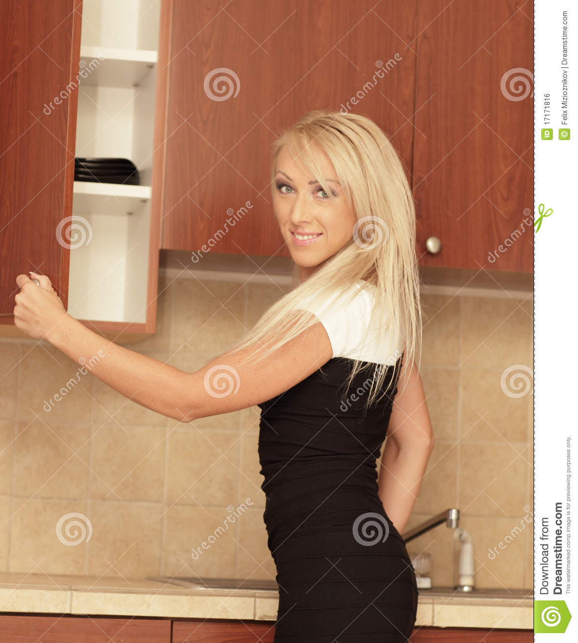Women Kitchen: Woman In A Kitchen Setting Stock Photo. Image Of Modern