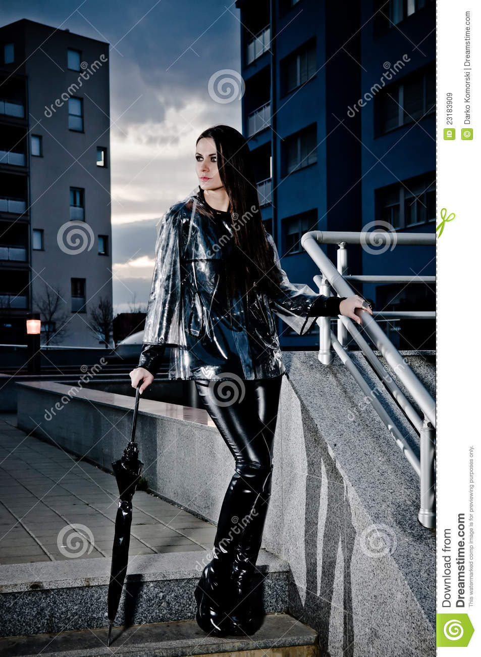 Sexy Woman In Leather And Raincoat Royalty Free Stock
