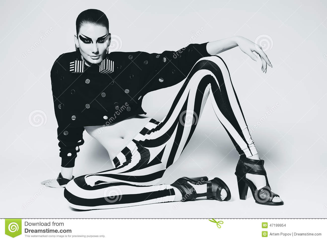 8bd6560905799 Stylish hair. Handsome guy in tank top and leggings on white background. A  charming Italian man · Woman in leggings with stripes sitting on the floor.