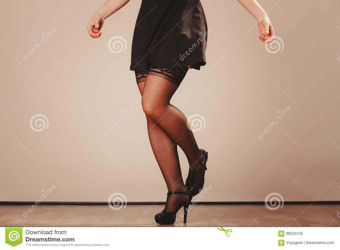 46e5f5211 Beauty and sexuality of women. part body woman model wearing black dress  skirt and pants stockings. Female legs in high heels.