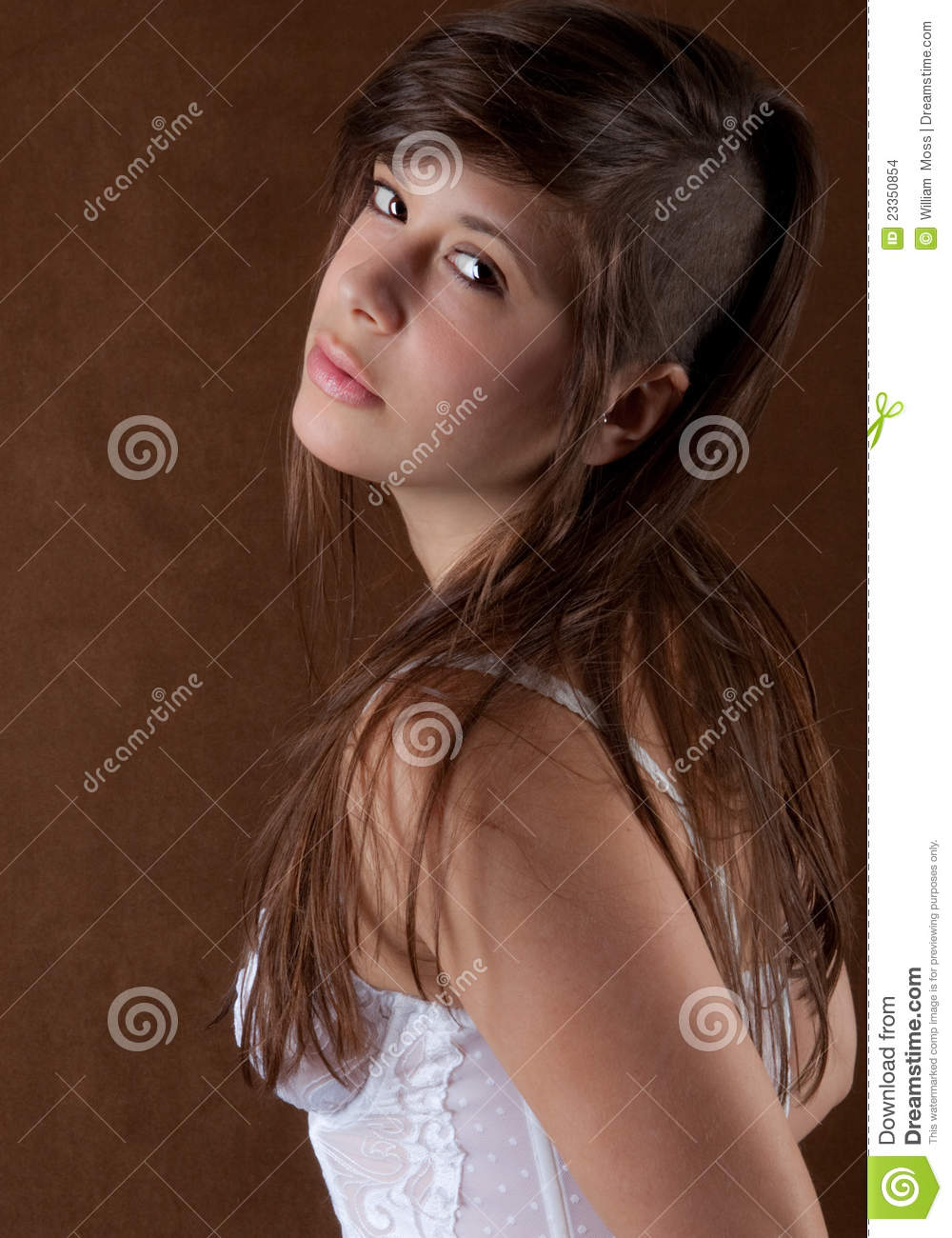 an attractive young woman with a stylish partially-shaved hairstyle