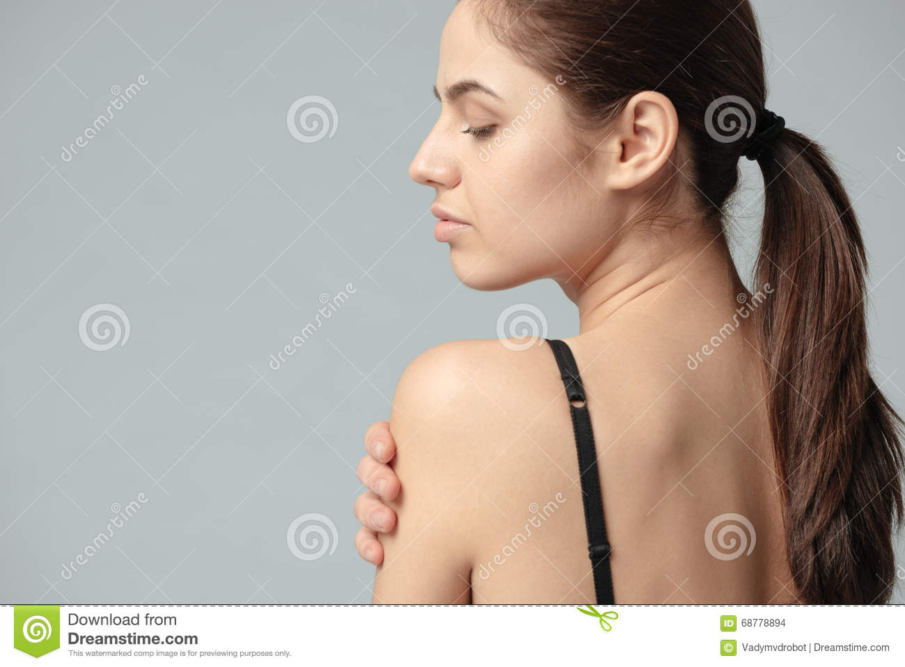 Woman Posing With Naked Shoulder Stock Photo - Image of