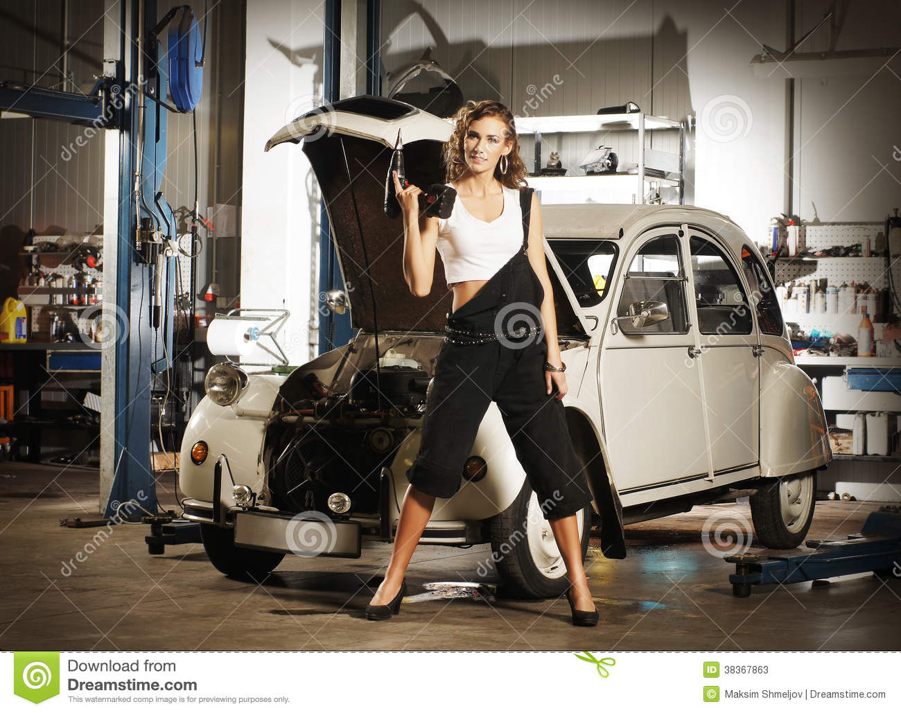 A woman repairing a car in a garage stock image image of for Garage happy car