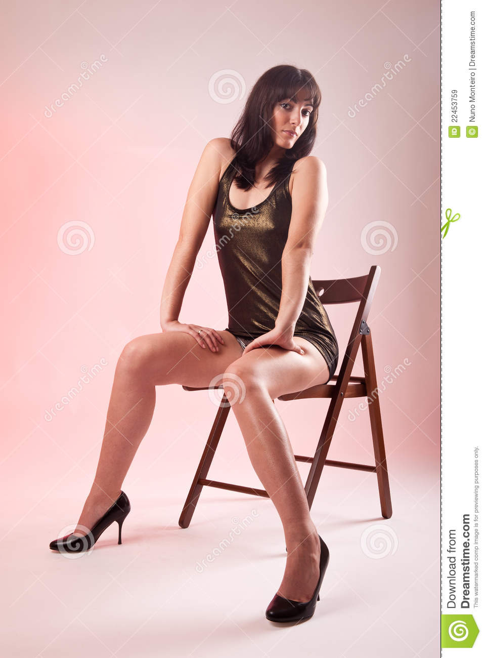 Woman Seated On Wooden Chair Royalty Free Stock Images