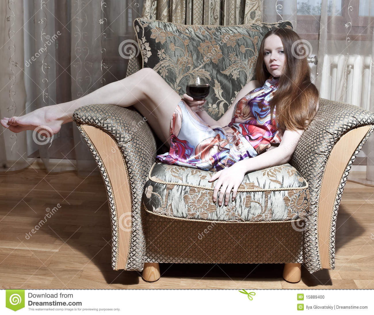 Sexy woman sitting on the armchair stock photo image for Sitting in armchair