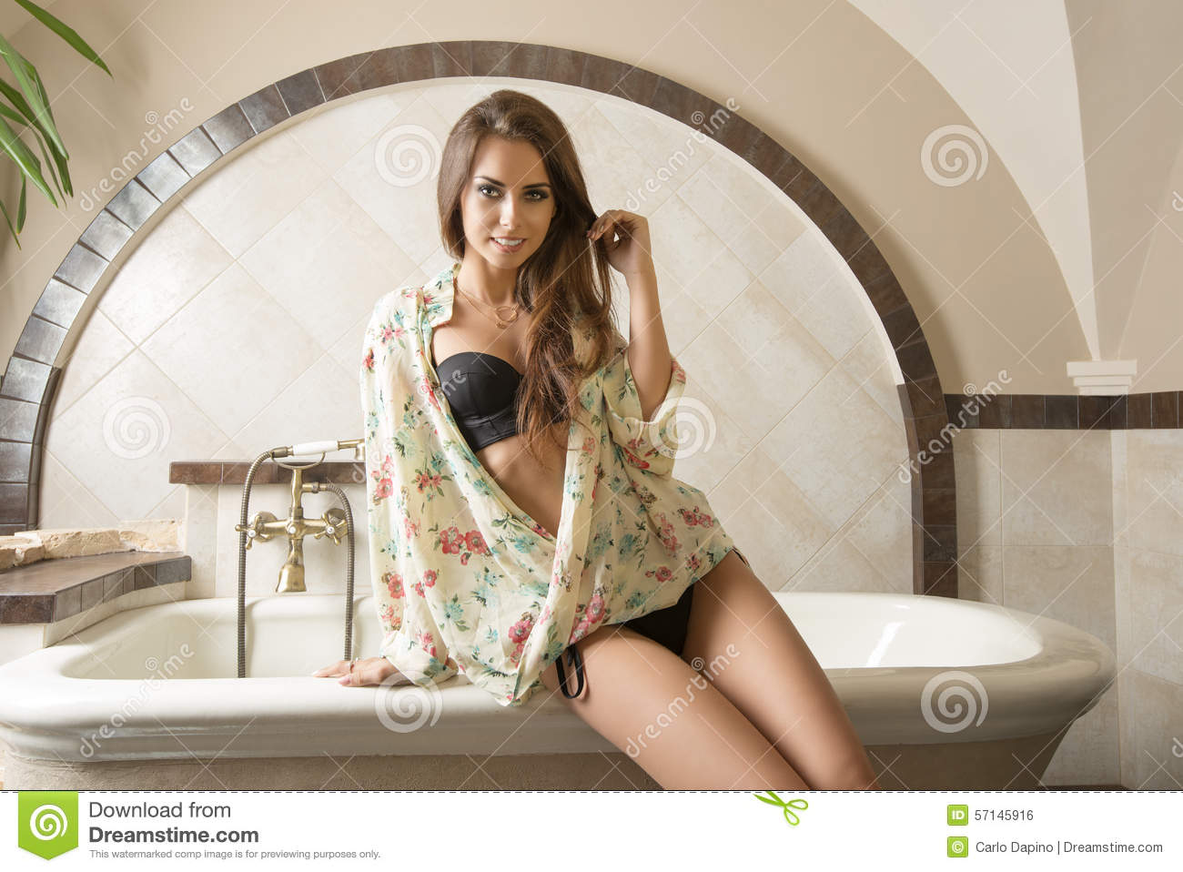 Woman sitting on bath tub stock photo image of charming for Hot bathrooms photos
