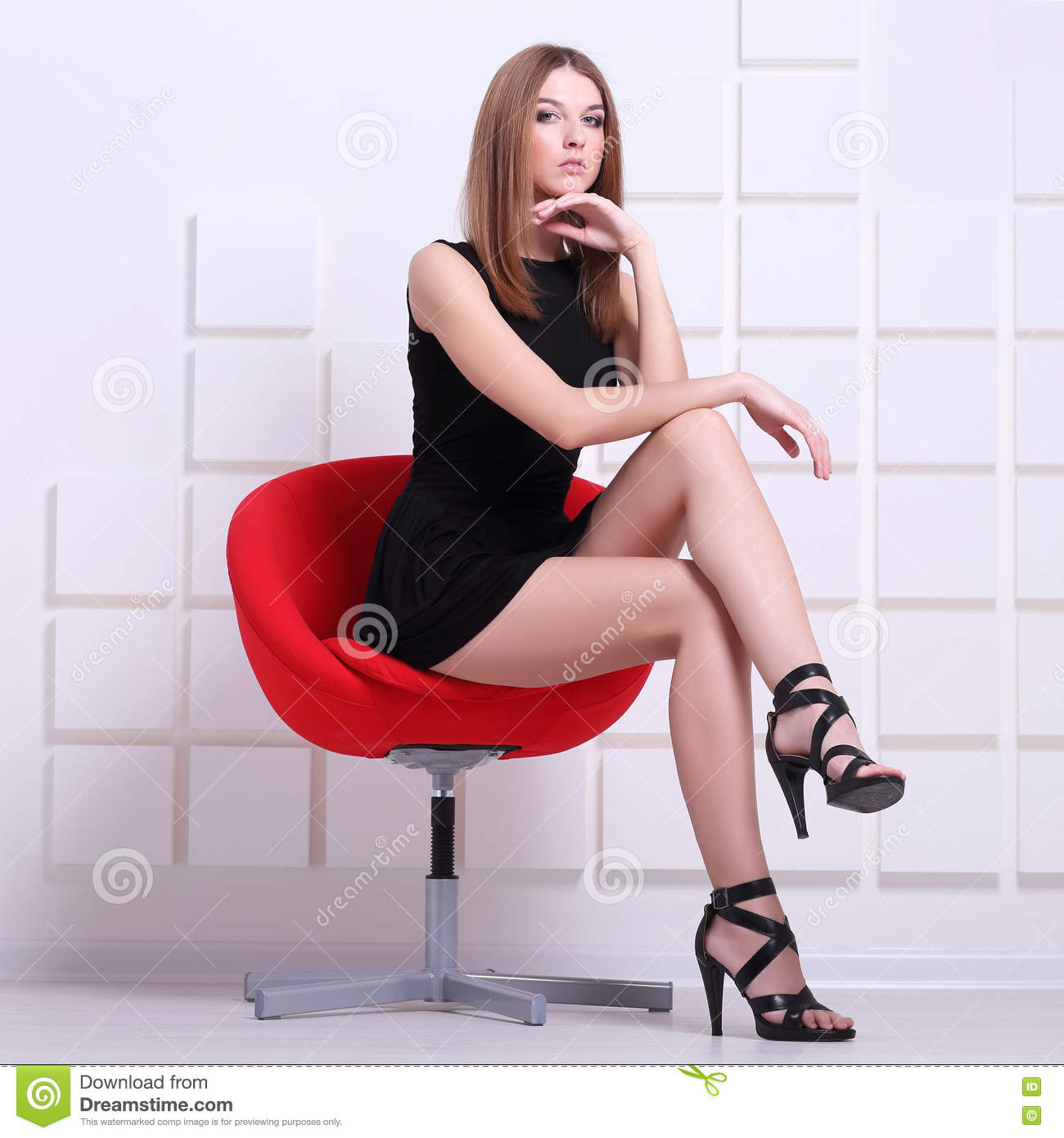 sexy girl sitting in chair