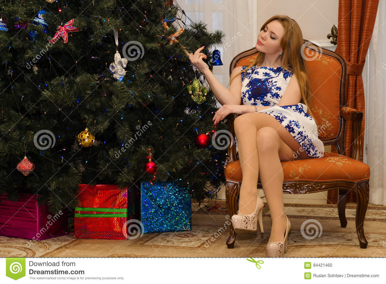 Woman Sitting On Chair With Legs Crossed Stock Photo