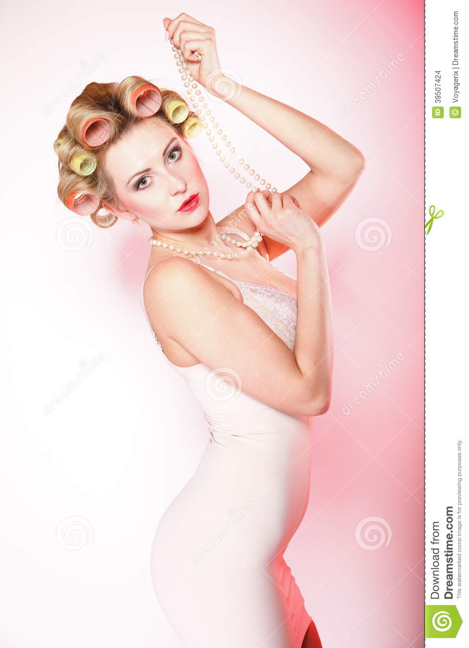 woman in underwear curlers with beads