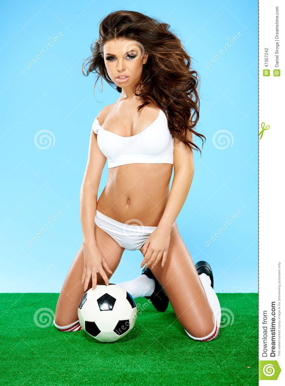 Close up Young Woman with Long Wavy Hair Wearing White Underwear Posing with  Soccer Ball While Kneeling on the Floor Seductively. c94b3dc5a