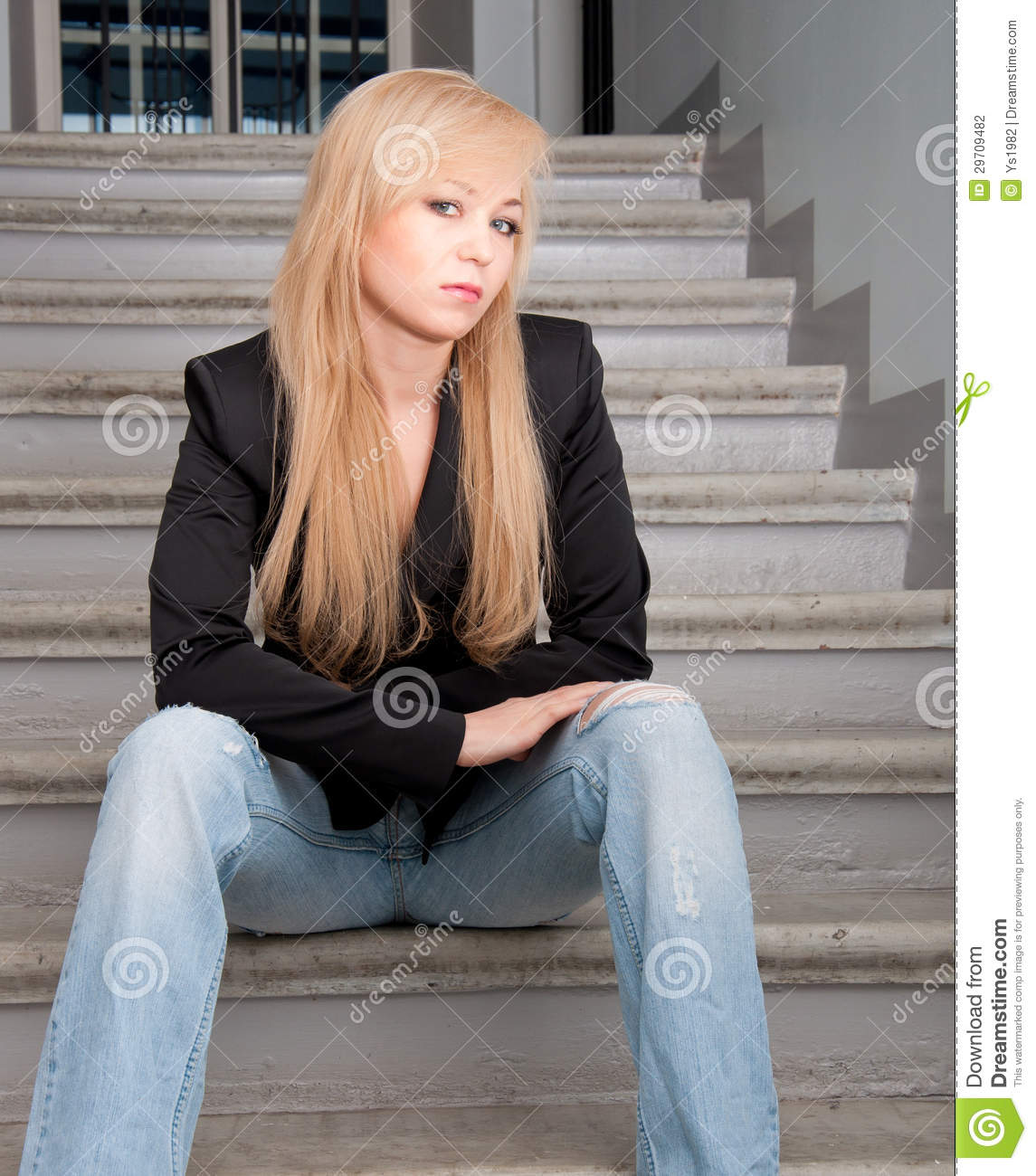 Woman Wearing Blue Jeans Sitting On A Stairs Stock Photography ...