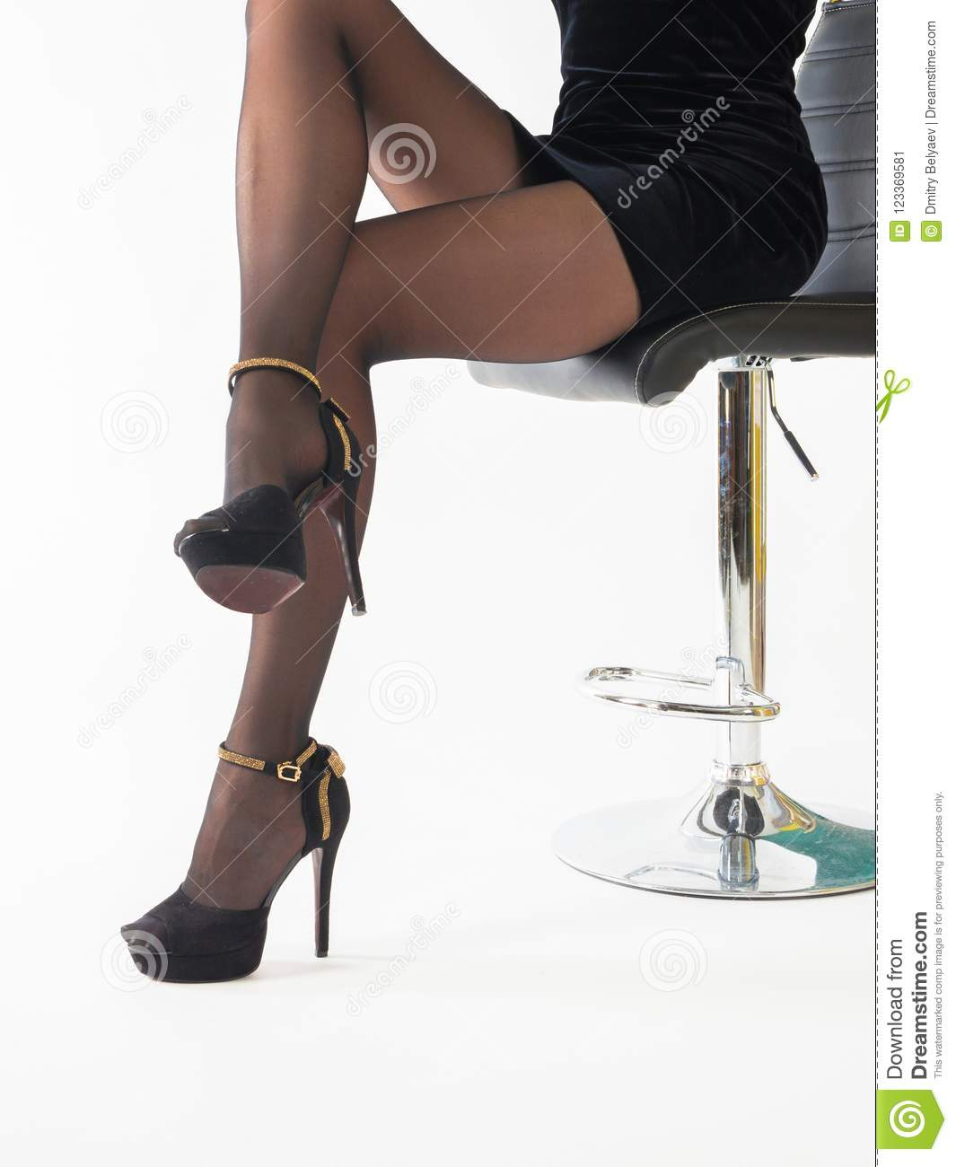 acb73e916cd woman wearing high heels shoes and short skirt sitting in office chair.  Isolated on white