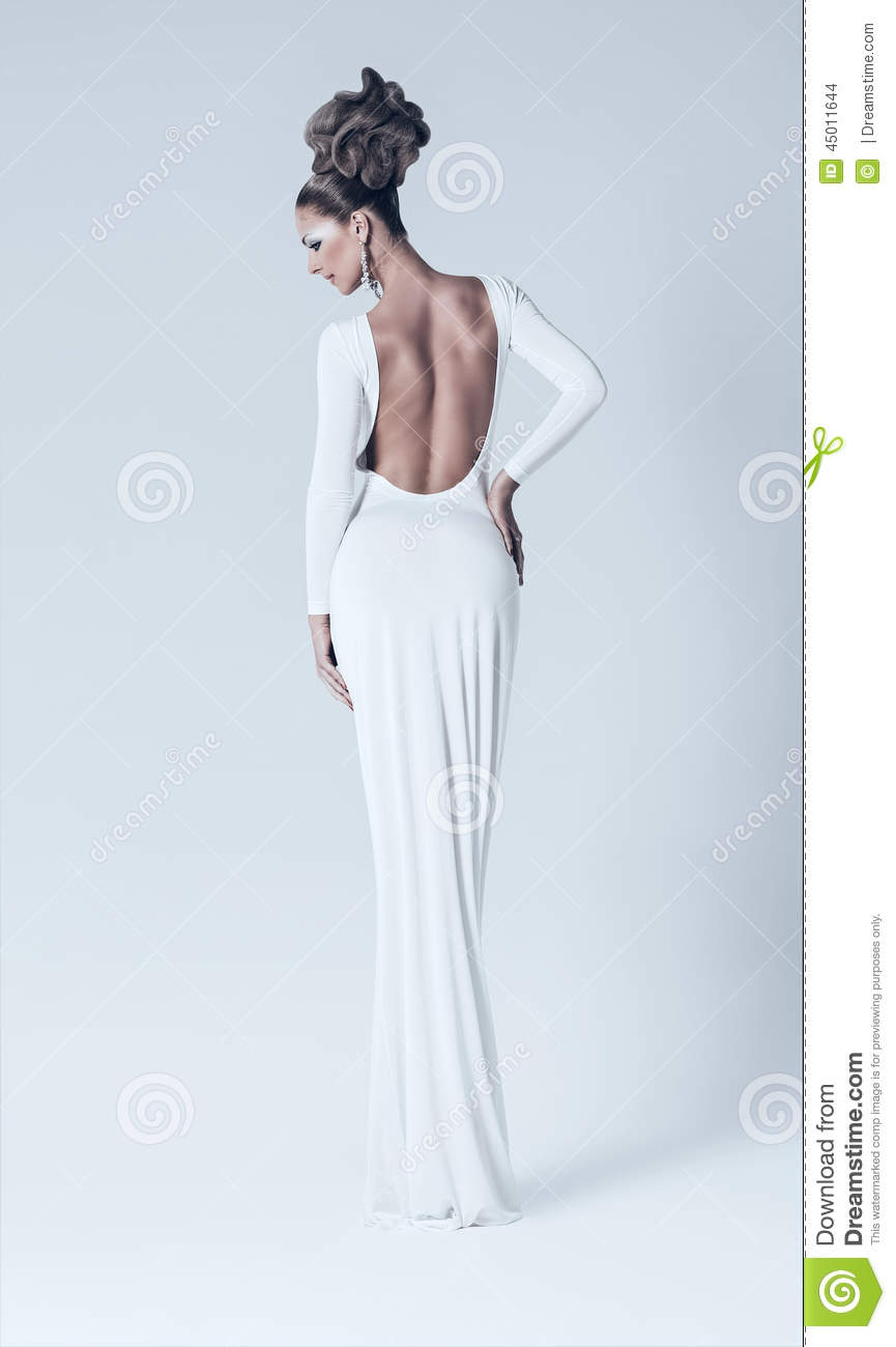 woman in white dress with naked back