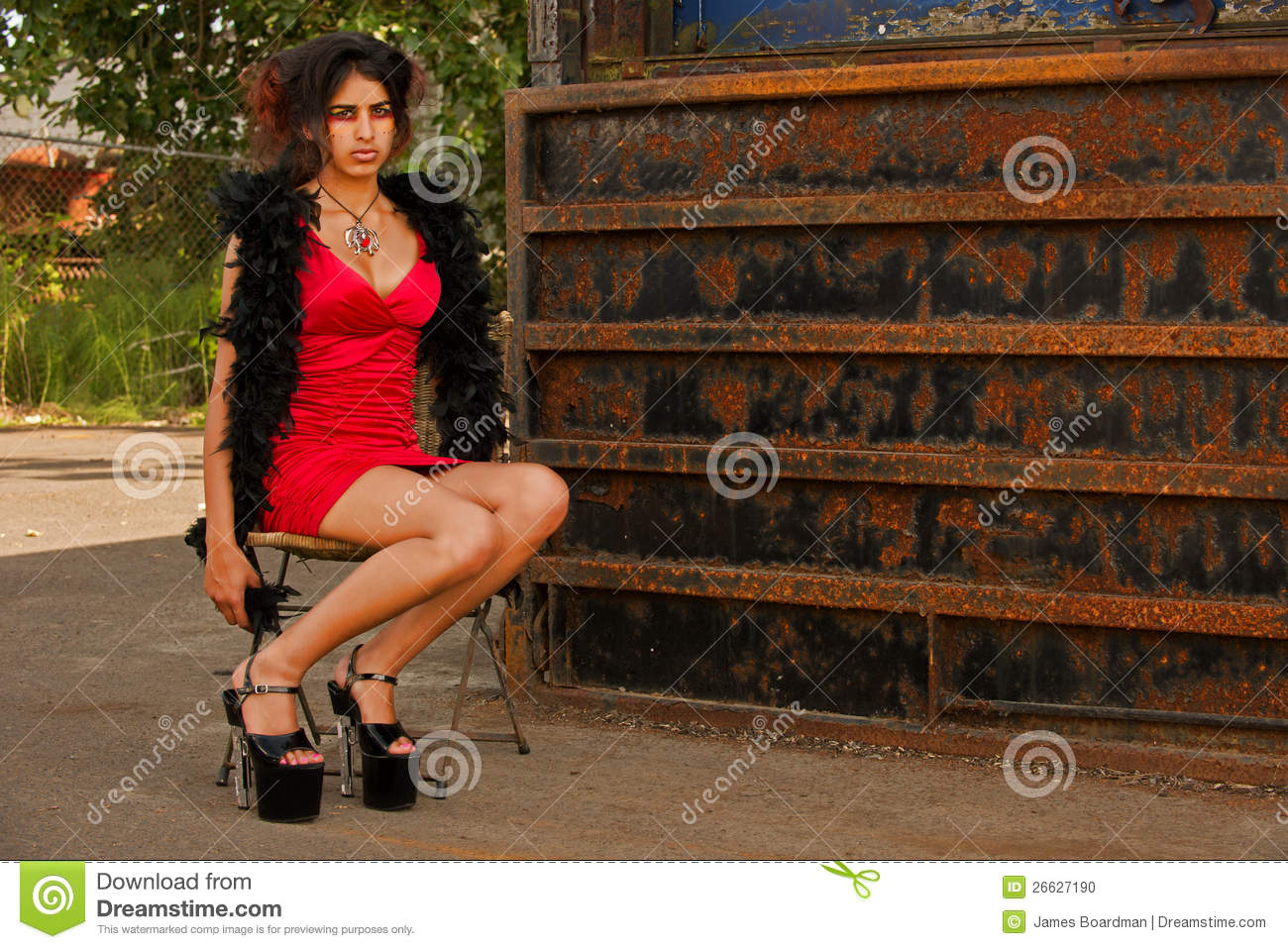 Sexy Working Girl Sitting In An Old Chair Stock Photo