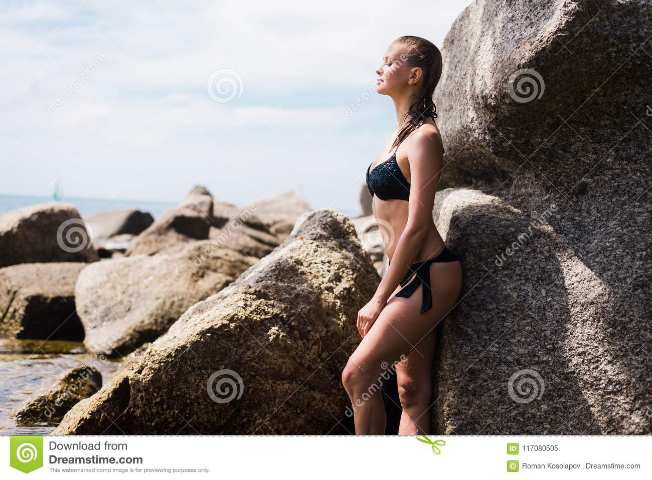 96bedddcf54 young beautiful russian girl in little black bikini. Slim body woman on  tropical beach in