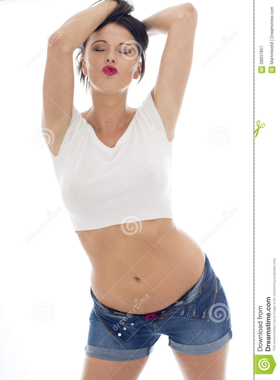3ae5c9733d Young Caucasian Woman, Wearing a White Vest Top and Blue Denim Shorts,  Posing Pin Up Against A White Background
