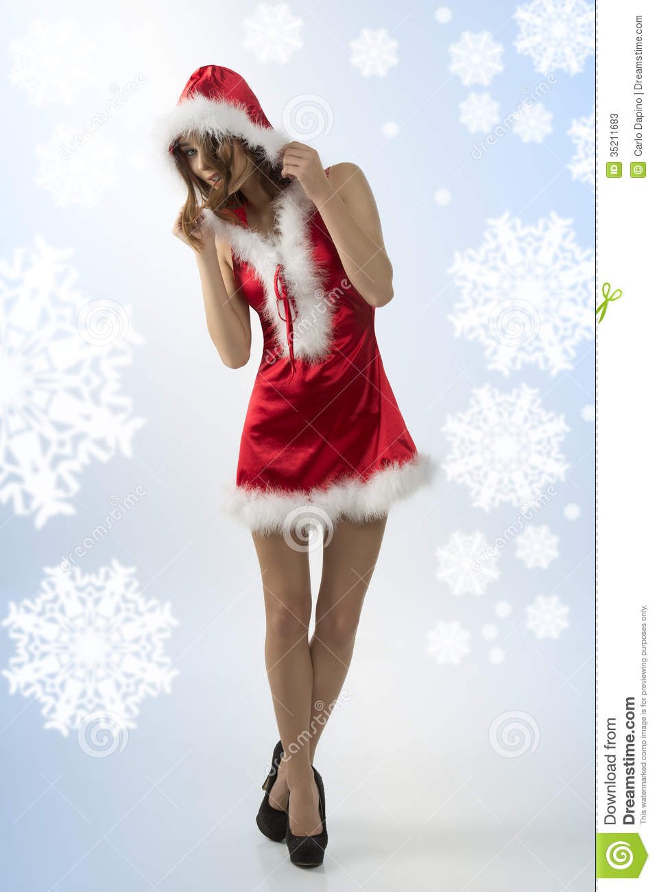 1e532cc625 Cute christmas female posing in full-length portrait with short red xmas  dress