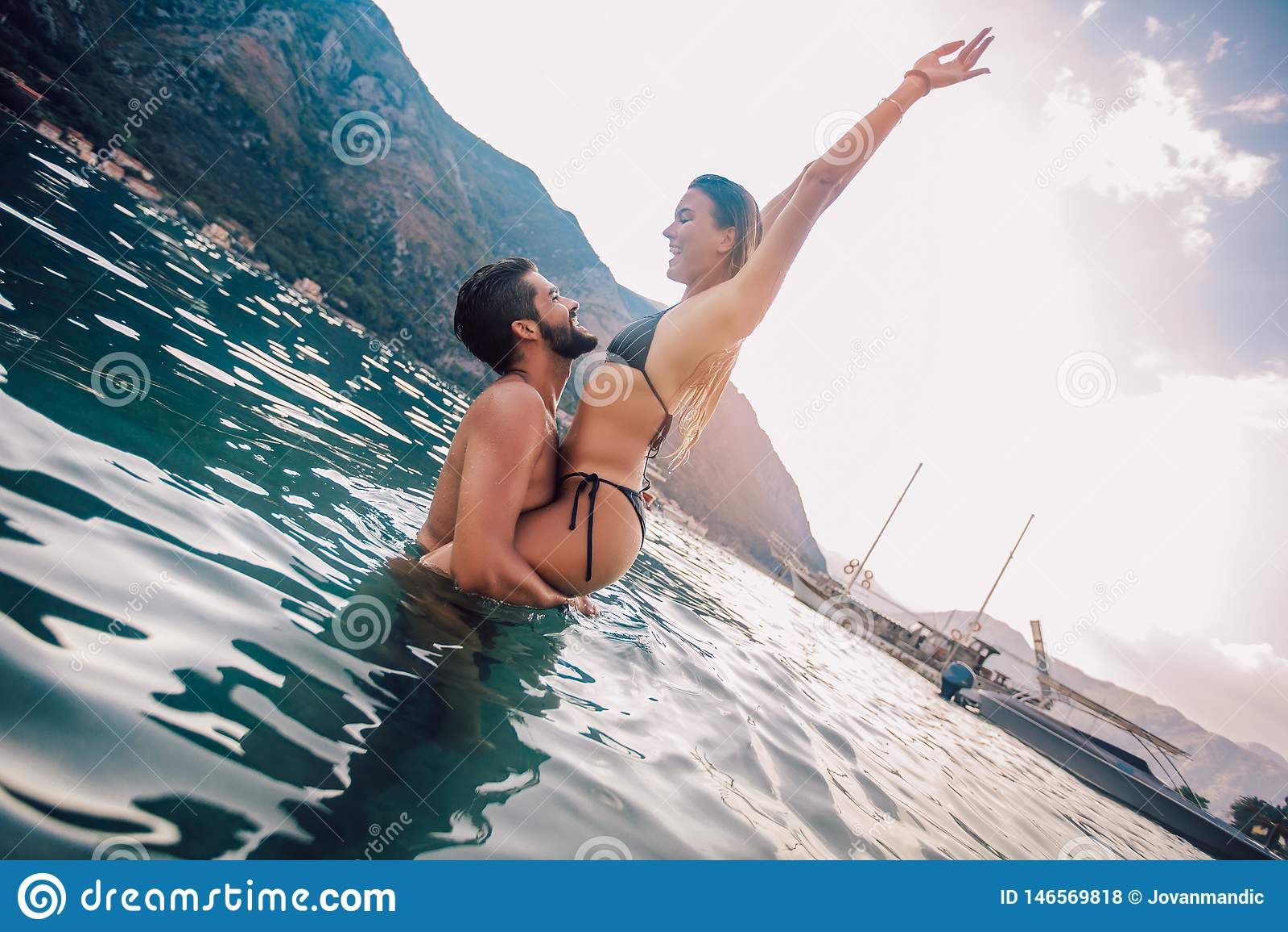 Young couple on the beach having fun